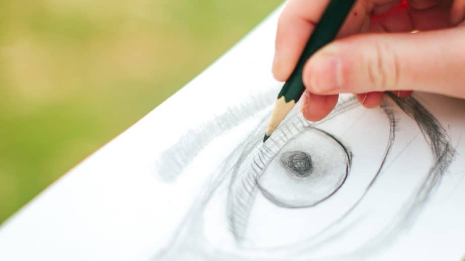 Close up of student drawing an eye with pencil