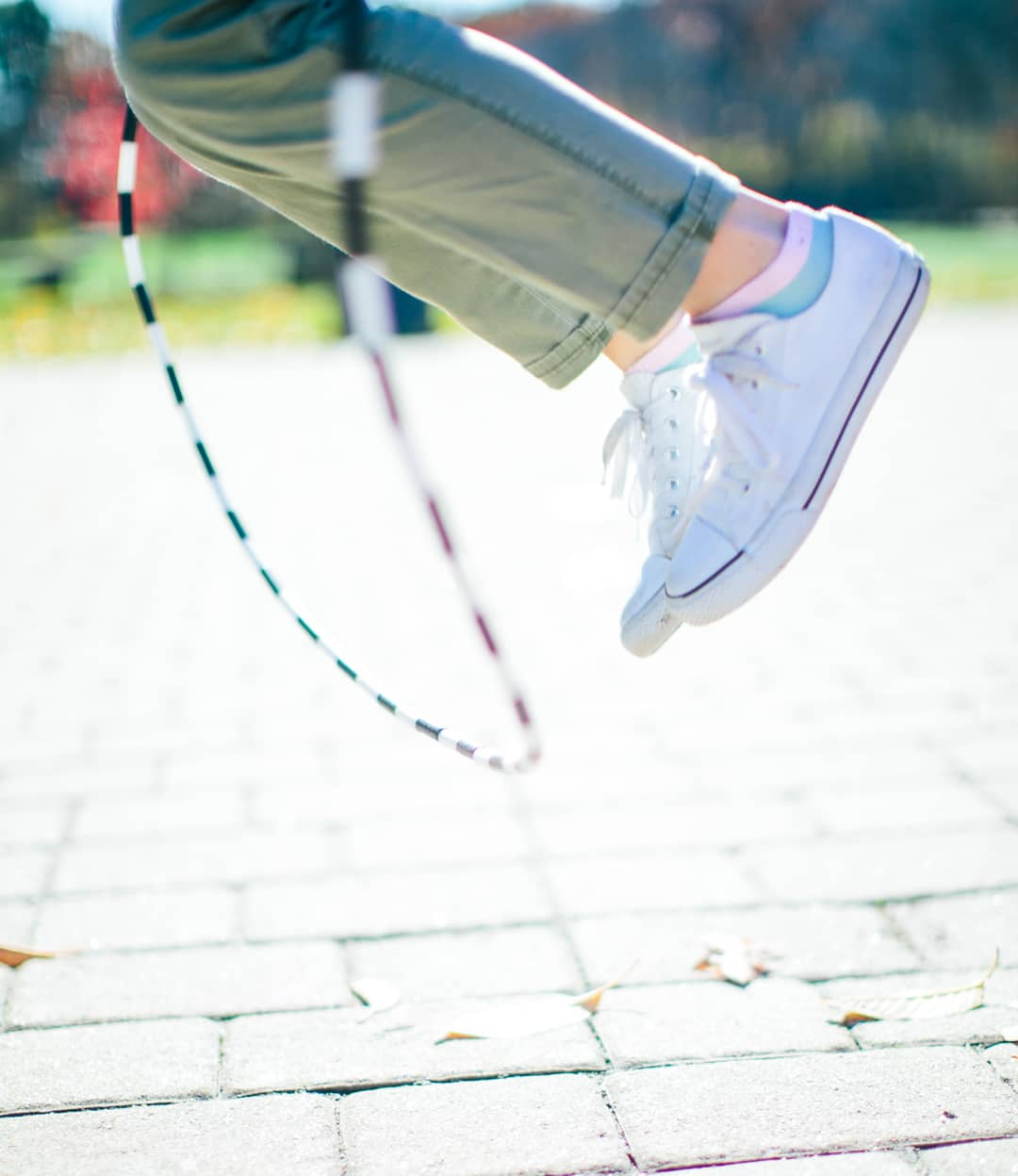Student's feet while mid-jump over rope