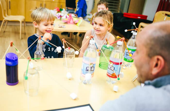 PreK students do experiment with plastic bottles