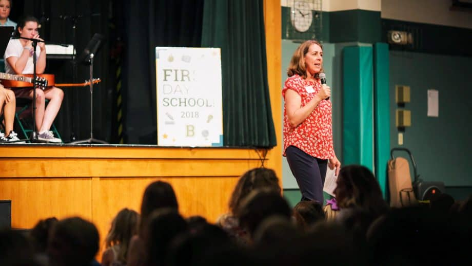Teacher speaks at school meeting