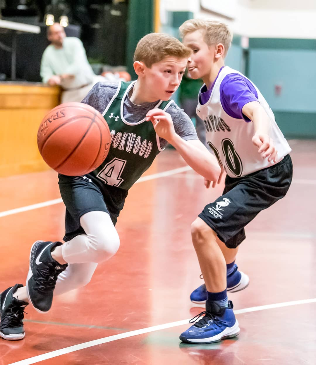 Student dribbles basketball during scrimmage