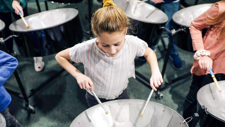 Top down view of student playing a metal drum