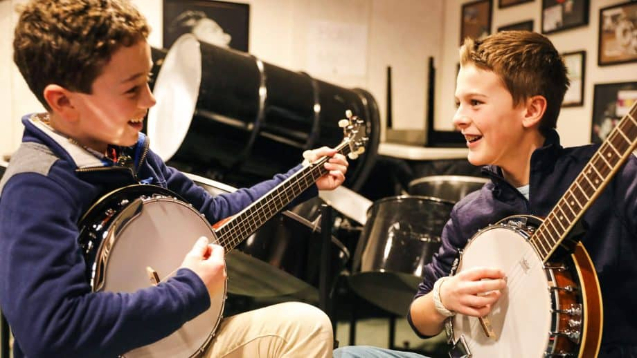 Two students play banjos together