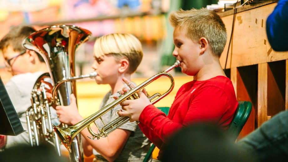 Students play brass instruments