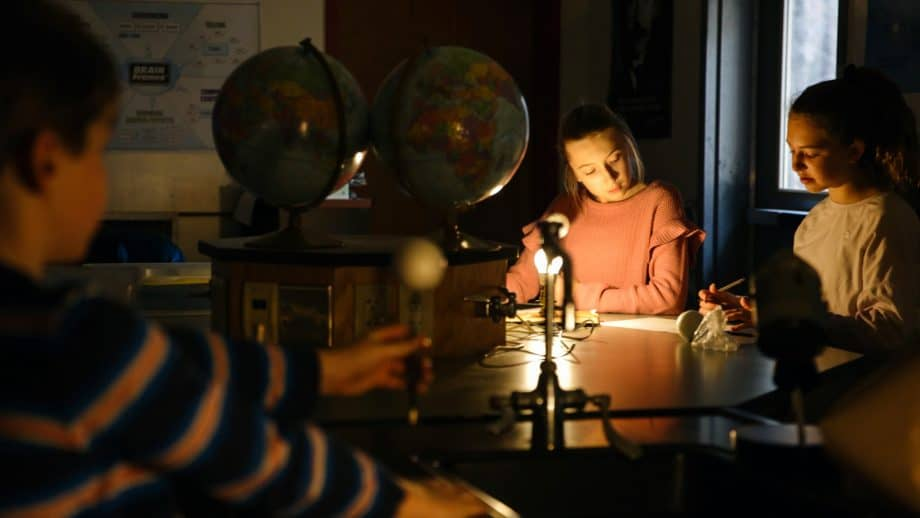 Students work in a dark science classroom