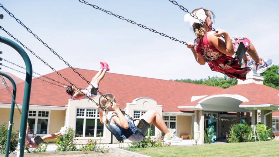 Students on swings during school recess