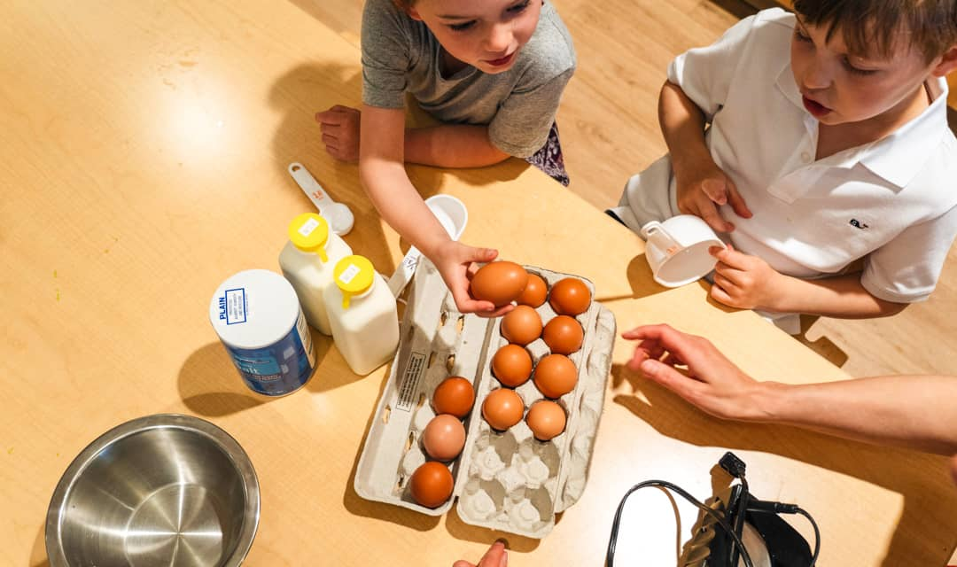 Young students help with baking