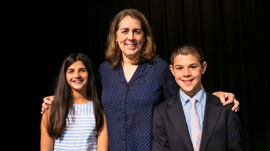 Head of School stand with student Declamation winners