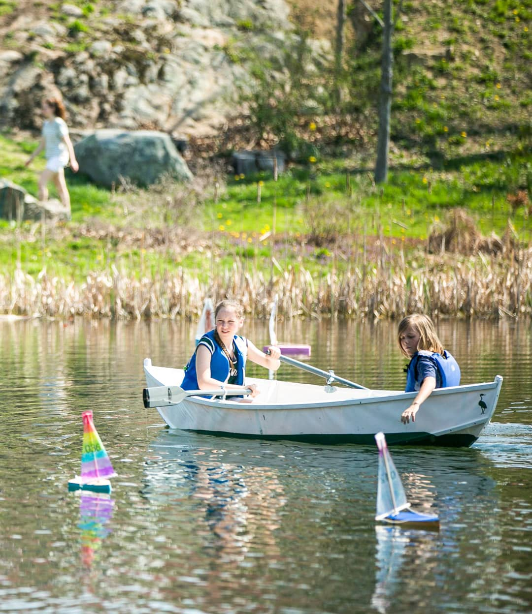 Students paddle boat during Recess Regatta