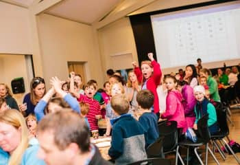 Students cheer during Bingo game